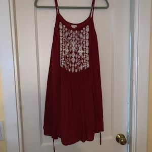 red flowing dress with pattern on chest